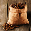 Coffee beans in bag on table — Stock Photo #25970175