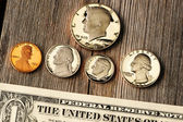US money over wooden background — Stock Photo