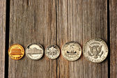 US cent coins over wooden background — Stock Photo