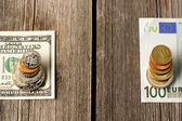 US and euro money over wooden background — Stock Photo