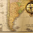 Antique compass over old XIX century map — Stok fotoğraf