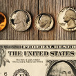 US money over wooden background — Stock Photo #26408745