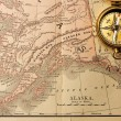 Antique compass over old XIX century map — Foto Stock