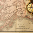 Antique compass over old XIX century map — Stock Photo #26408827