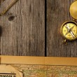 Antique compass over old map — Stock Photo #26408971