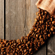 Coffee beans and bag background — Stock Photo