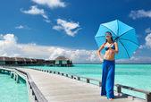 Woman on a beach jetty at Maldives — Stock Photo