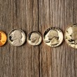 Stock Photo: US cent coins over wooden background