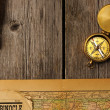 Stock Photo: Antique compass over old map