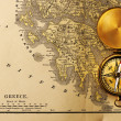 Stock Photo: Antique compass over old XIX century map