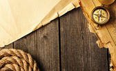 Antique compass and rope over old map — Stock Photo