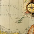 Antique compass over old XIX century map — Stock Photo #27343461