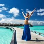 Woman on a beach jetty at Maldives — Stock Photo #27343505
