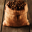 Coffee beans in bag on table — Stock Photo