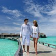 Couple on a beach jetty at Maldives — Stock Photo