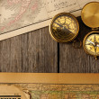 Antique compasses over old map — Stok fotoğraf
