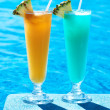 Cocktails near swimming pool — Stock Photo #28039405