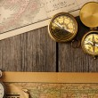 Antique compasses over old map — ストック写真