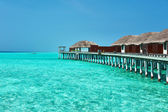 Beautiful beach with water bungalows — Stock Photo