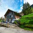 Swiss chalet at Alps — Stock Photo