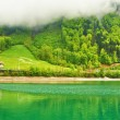 Beautiful emerald mountain lake in Switzerland — Stock Photo