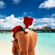 Couple in santa's hat on a beach at Maldives — Stock Photo #33054505