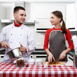 Couple at kitchen — Stock Photo