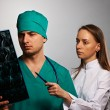Medical doctors team with MRI spinal scan — Stock Photo #34049621