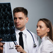 Medical doctors team with MRI spinal scan — Stock Photo #34049641