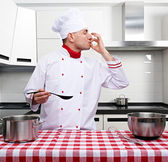 Male chef at kitchen — Stock Photo
