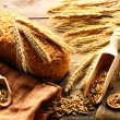 Rye spikelets and bread — Stock Photo