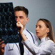 Stock Photo: Medical doctors team with MRI spinal scan