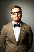 Confident nerd in eyeglasses and bow tie — Stock Photo