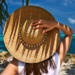 Womwith sun hat at beach — Stock Photo #39849213