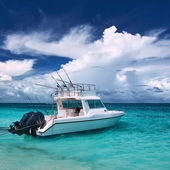 Beautiful island beach with motor boat — Stock Photo