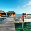 Stock Photo: Beach with water bungalows
