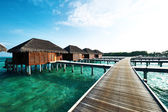Beach with water bungalows — Stock Photo