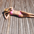 Womsunbathing lying at deck — Stock Photo #40798557