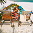 Couple in green on beach at Maldives — Stock Photo #41251121