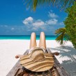 Stock Photo: Womat beach lying on chaise lounge