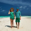 Couple in green on a beach at Maldives — Stock Photo #42166547