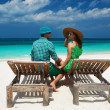 Couple in green on a beach at Maldives — Stock Photo