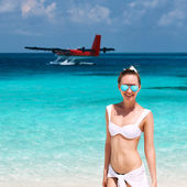 Woman at beach. Seaplane at background. — Foto de Stock