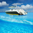 Beach and motor boat with white sand bottom underwater view — Stock Photo #42911461