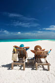 Couple relax on a beach at Maldives — Stock Photo