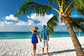 Couple in blue clothes on a beach at Maldives — Stock Photo