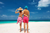 Couple in blue on a beach at Maldives — Stock Photo
