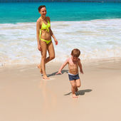Mother and two year old boy playing on beach — Stock Photo