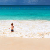 Two year old boy playing on beach — Stock Photo