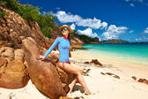 Woman at beautiful beach wearing rash guard — Stock Photo